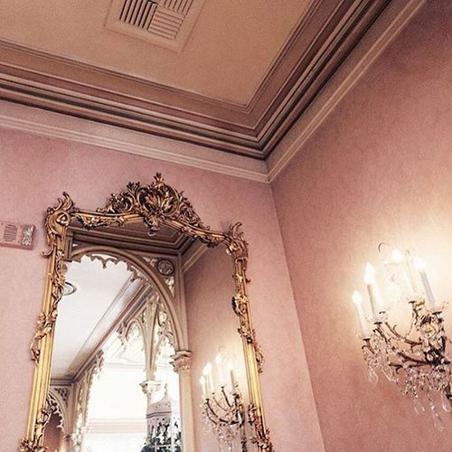 antique gold framed mirror and chandelier + rose gold