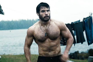 Henry Cavill as Clark Kent, bearded in the wilderness, muscular physique, shirtless bodybuilder, Man of Steel, Directed by Zack Synder