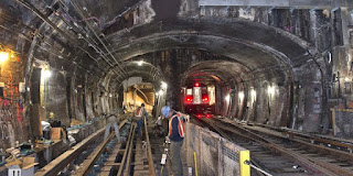 Superstorms sow havoc: Repair work on the New York metro in Sandy's devastating wake. (Image Credit: Metropolitan Transportation Authority of the State of NY via Wikimedia Commons) Click to Enlarge.