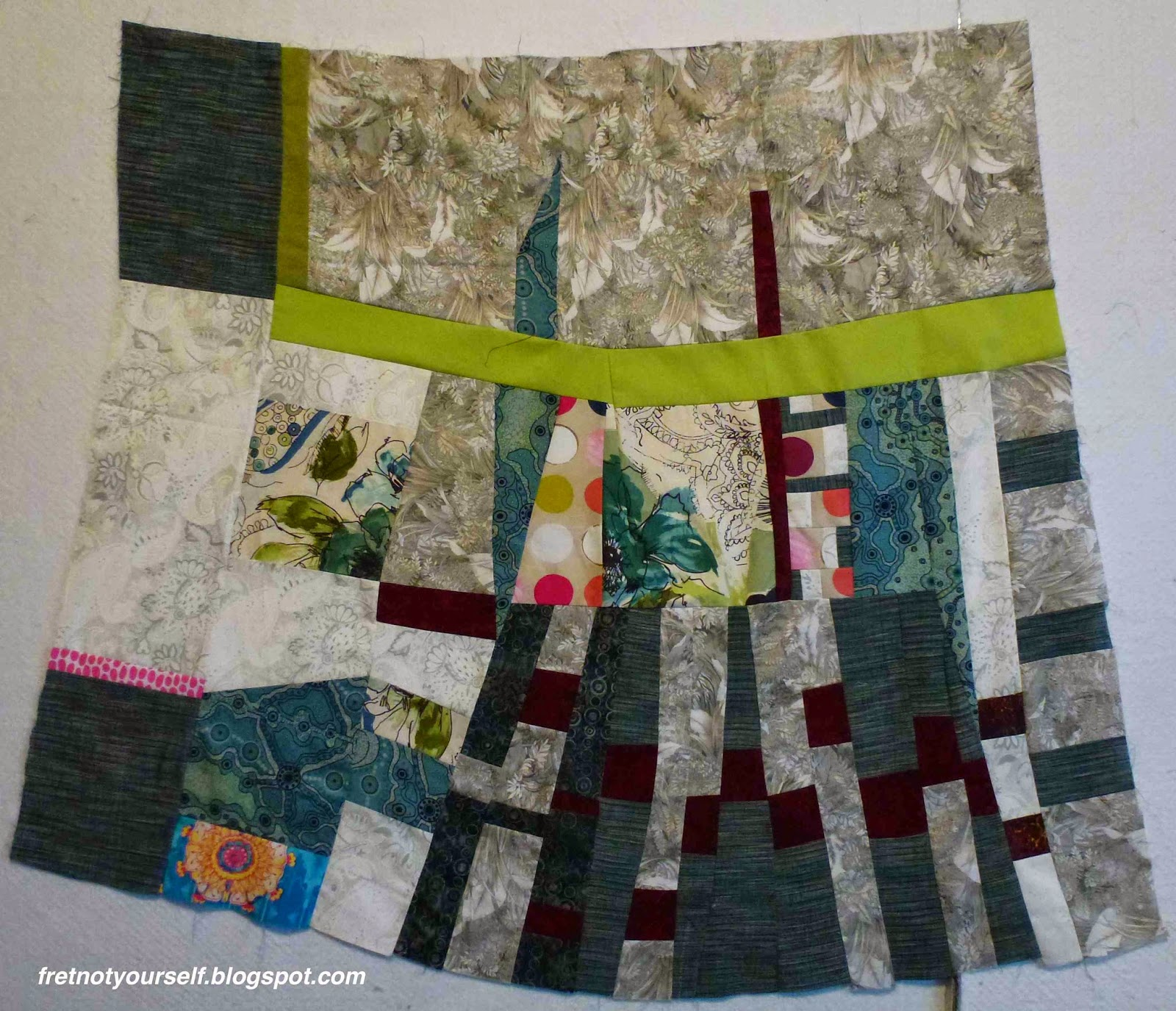 Dark blue, dark red, grey and green fabrics were used to make this improvisational quilt.