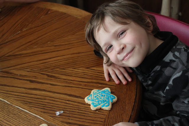 Want to teach your kids about Hanukkah in a delicious way they will remember? These easy DIY Chanukah cookies, donuts, and houses are so much fun and tasty, too!