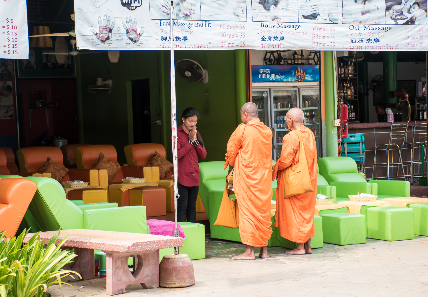 Monks praying and giving blessings in the siem reap market