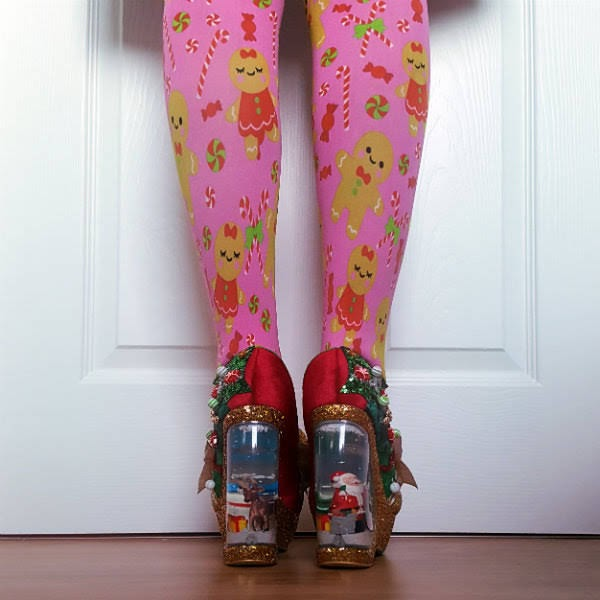back view of snowglobe heeled shoes on feet with pink Christmas tights