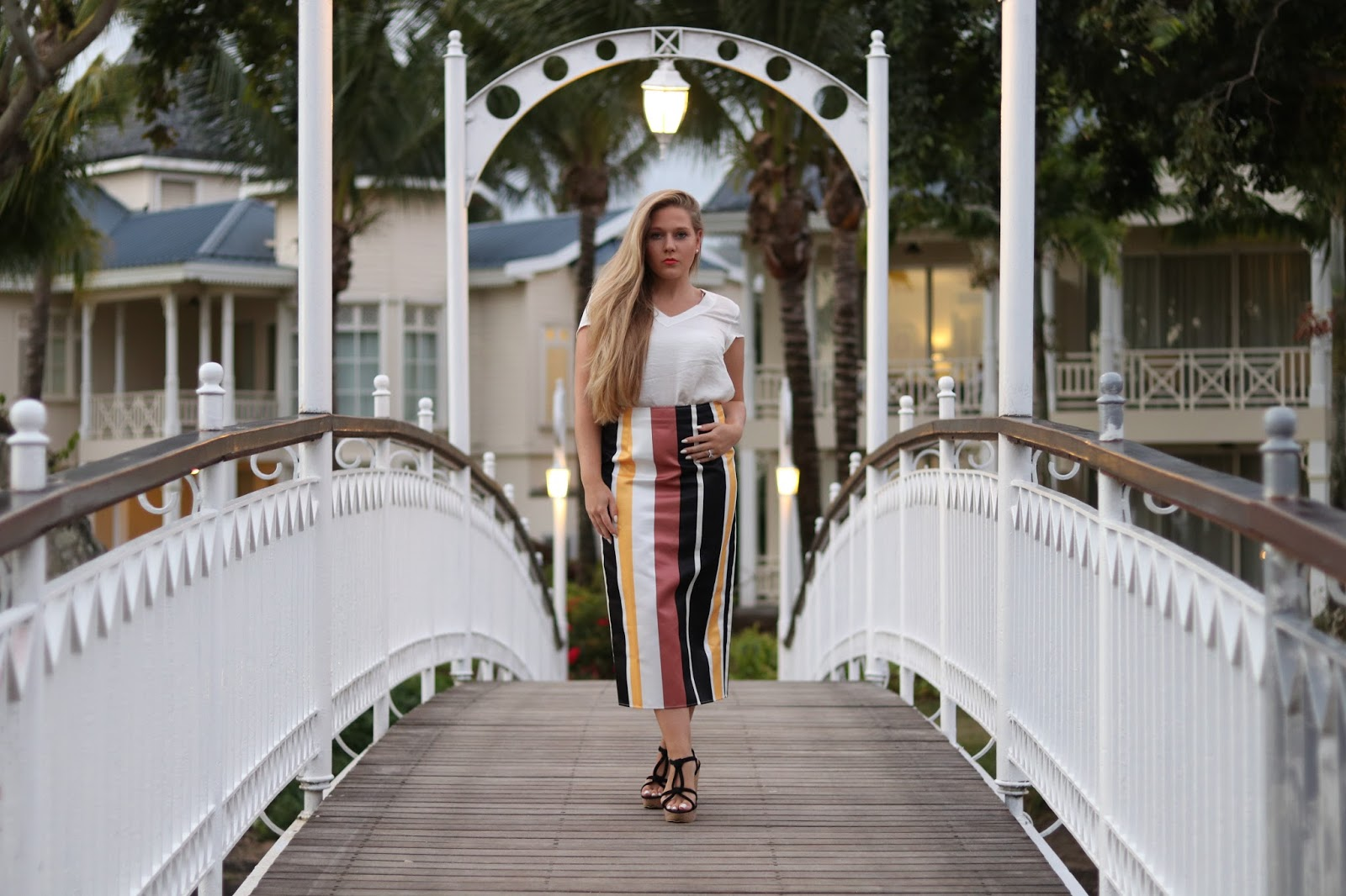 Katie Heath wearing an ASOS skirt at the Heritage Le Telfair Hotel, Mauritius