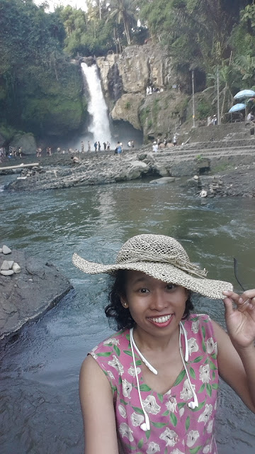 Selfie with panorama of Tegenungan Waterfall, Bali, Indonesia
