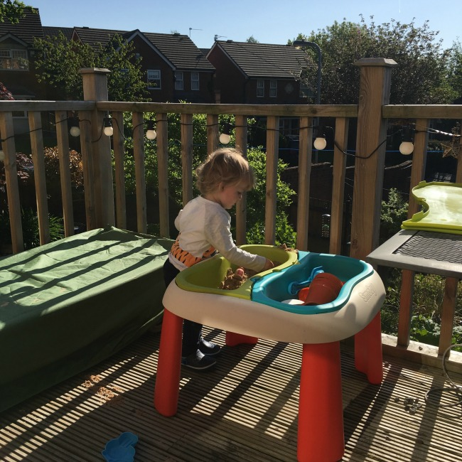 toddler in garden in sunshine