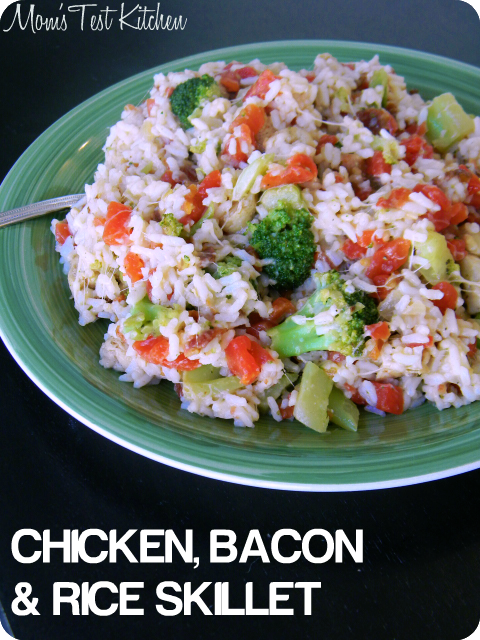 Labeled photo of Chicken, Bacon & Rice Skillet Meal on a green plate with a serving spoon.