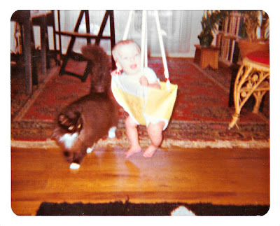 Vintage picture of a baby and a cat, taken at 1776 Sweetwood Drive in Broadmoor in the late 1970's.