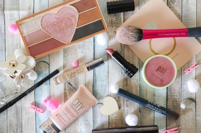 Makeup products and love hearts on a wooden background