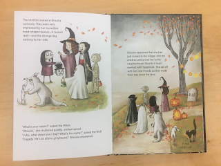 A two-page spread depicting Ghoulia introducing herself to other kids dressed as a witch, vampire, mummy, and ghost.