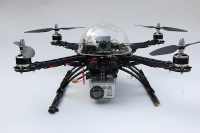 This is a Quadcopter. [A quadcopter, also called a quadrotor helicopter or quadrotor, is a multirotor helicopter that is lifted and propelled by four rotors.]