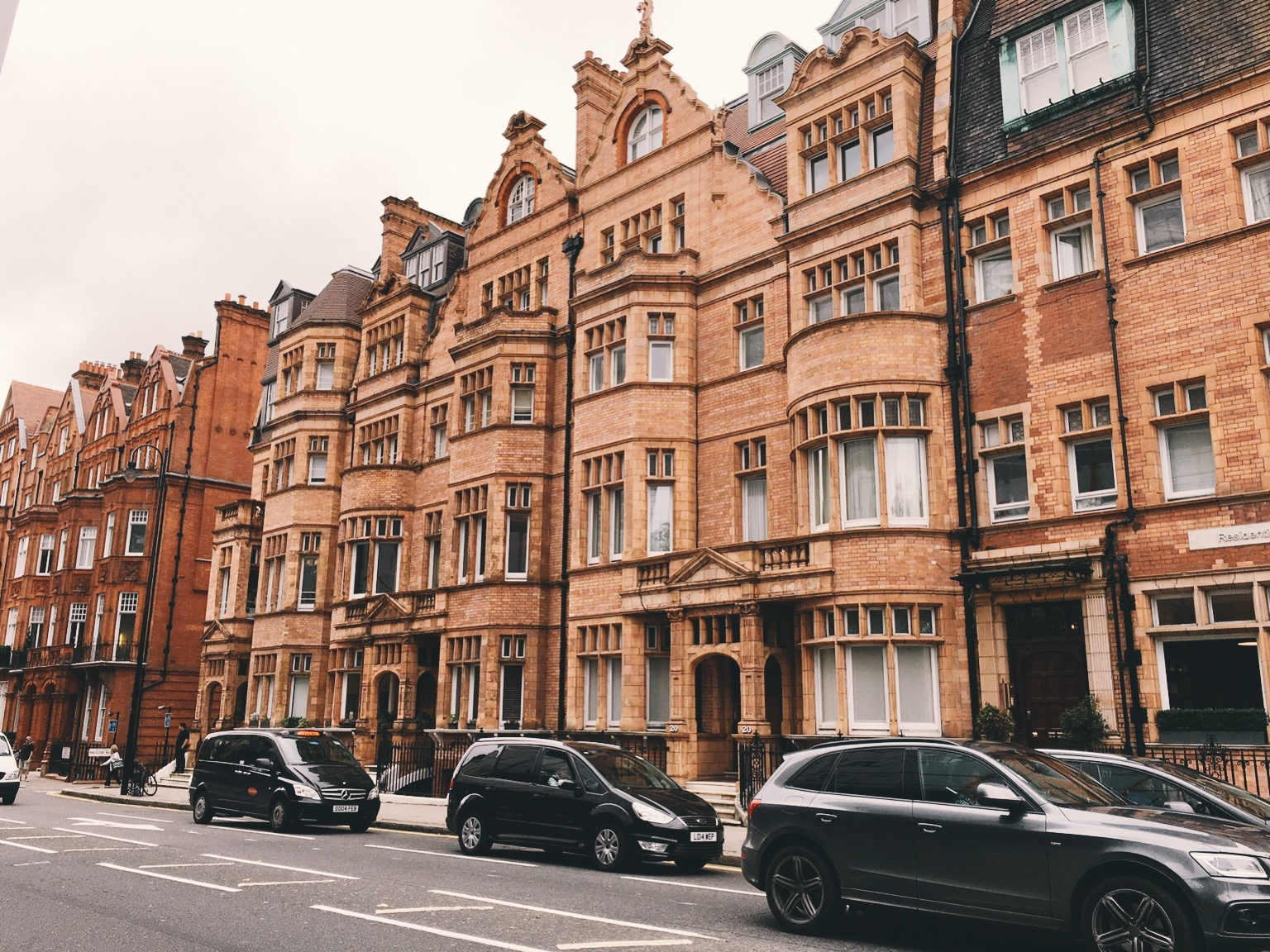 Brick buildings and taxi cabs in London
