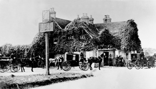 Photograph of The Swan, Bell Bar, in the 1900s, still an important stopping place for horse-drawn carriages Image from the NMLHS archive