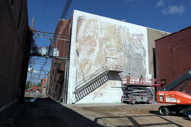Vhils and his crew are also in Fort Smith, Arkansas where they've been working on a new piece for the first edition of the Unexpected Street Art Festival.