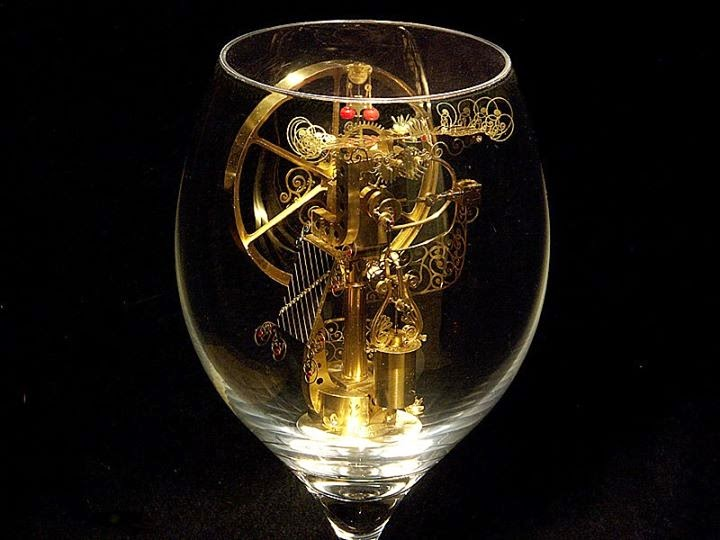 09-Solar-Kinetic-Miniature-Sculptures-in-a-Glass-Goblet-www-designstack-co
