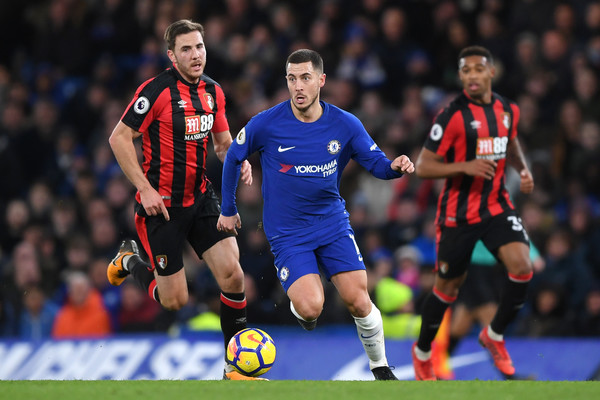 Eden Hazard of Chelsea runs with the ball away from the pressure of Dan Gosling of AFC Bournemouth during the Premier League match between Chelsea and AFC Bournemouth at Stamford Bridge on January 31, 2018 in London, England.