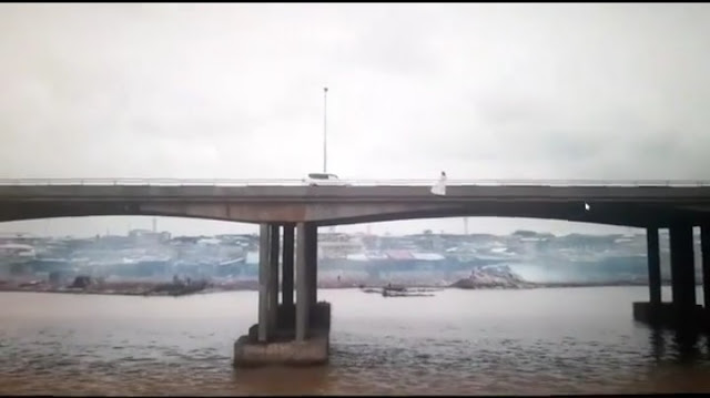 Students captures video of woman attempting to jump off 3rdmaninland bridge.