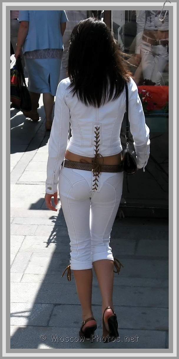Skinny russian lady in white fitted summer suit
