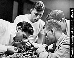Mack, at left, performs an autopsy as a student at Harvard Medical School, 1951
