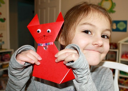 Tessa blinged up her origami cat with supplies from her craft kit.
