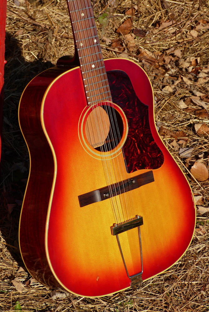 Jake wildwood 1961 gibson b 45 12 slope dread 12 string guitar 2 tight hairline crack on the lower bout and a 1 tiny hairline invisible at the very top left of the pickguard next to the fretboard extension sciox Images