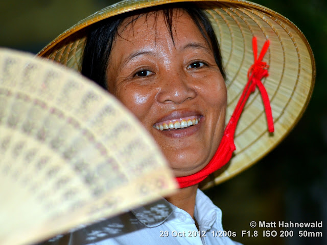 Asian conical hat, conical straw hat, Vietnamese style conical hat, nón lá, sedge hat, rice hat, paddy hat, Vietnamese woman, portrait, headshot, Vietnam, Hanoi