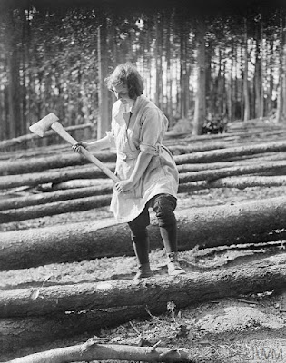 "A portrait of a member of the Women's Forestry Corps, part of the Women's Land Army, as she uses an axe to ""mark for cross cuts"". IWM Non-Commercial Licence © IWM (Q 30695)"
