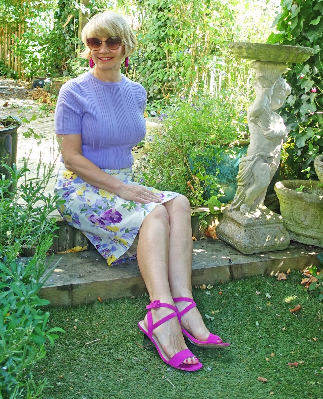 Over 45s blogger Gail Hanlon in lilac and yellow floral skirt, bought secondhand from eBay, lilac top and pink sandals