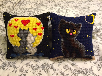 Pillows with cats embroidered on them