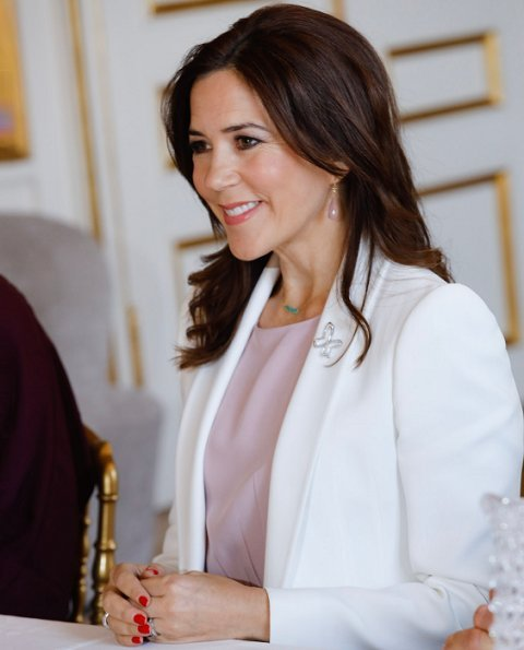 Crown Princess Mary wore Isabel Marant pink blouse, and she wore a white blazer and wear Marianne Dulong pink diamond earrings