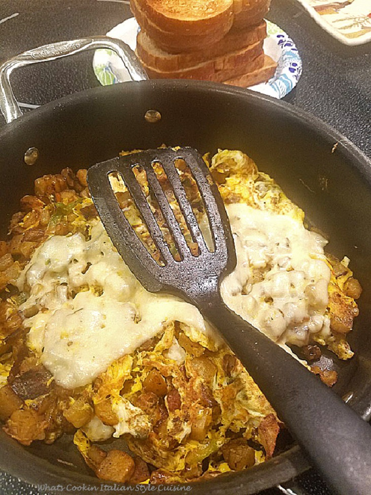 This is a potato and egg made in a fry pan with melted cheese on top called an Italian Frittata and Italian speciality for breakfast