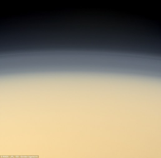This image shows Titan's atmosphere. This object is the only world in the solar system have liquid on its surface than Earth that formed the sea or a lake. But here the liquid is not water but methane and ethane liquid.