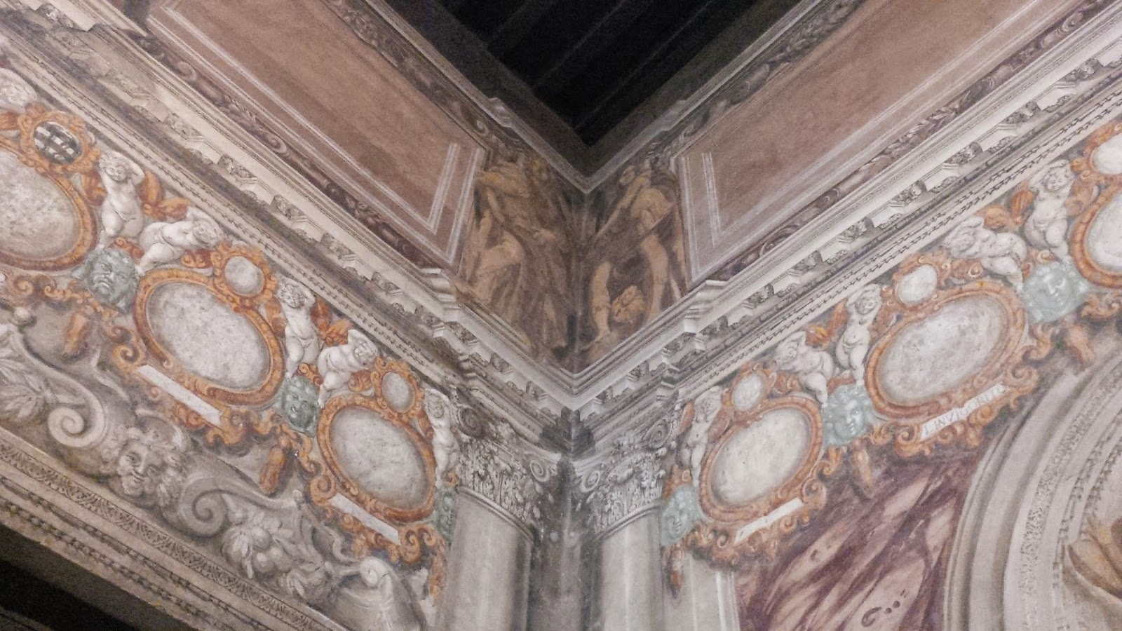 A detail of the richly painted walls of the antechamber of Teatro Olimpico in Vicenza