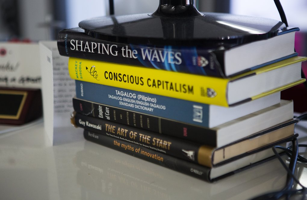 Books under a monitor (credit to https://www.seattletimes.com)