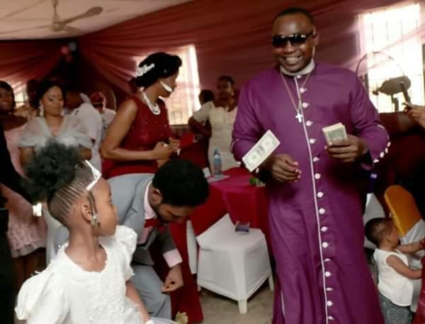 Nigerian Pastor Sprays Dollars At A Wedding In Lagos (Photos)