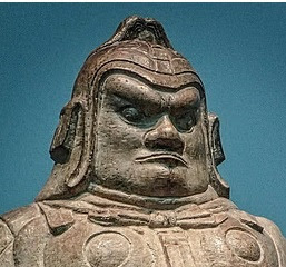 Chinese Dvarapala or door-guardian wearing a tight-fitting head-dress, Tang dynasty, 7th century AD