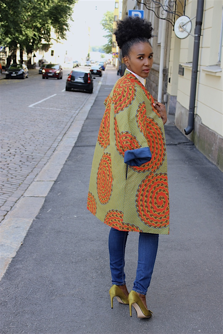 lady in a colorful coat with her back turned