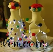 http://clarabelen.com/inspiraciones/2840/lamparas-con-botellas-de-plastico-con-forma-de-arbol-de-navidad/