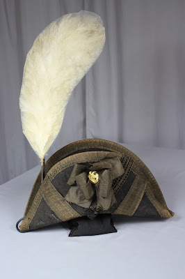 Exhibit mount to display chapeau and plume together. each mount is separate, yet works together. Spicer art Conservation art conservator, preservation, repair, military collectibles, artifacts, antiques, textiles objects and paper conservation.