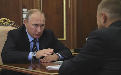 Vladimir Putin at the meeting with President of OPORA Russia public association Alexander Kalinin.