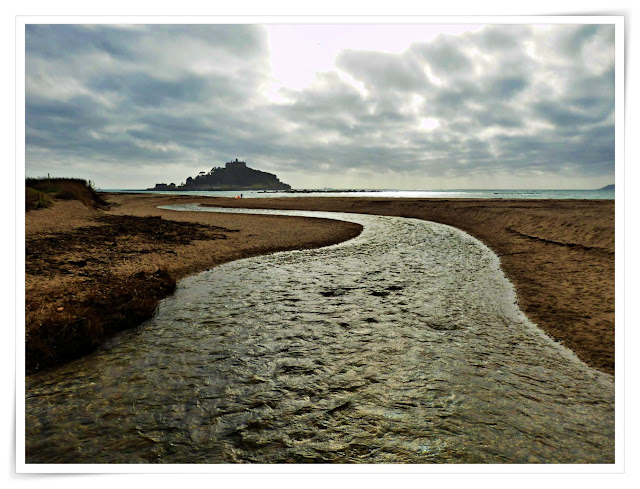 River joining the sea with St. Michael's Mount in the background
