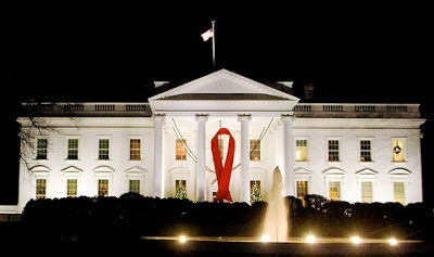 White House at nighttime with the Red AIDS Ribbon