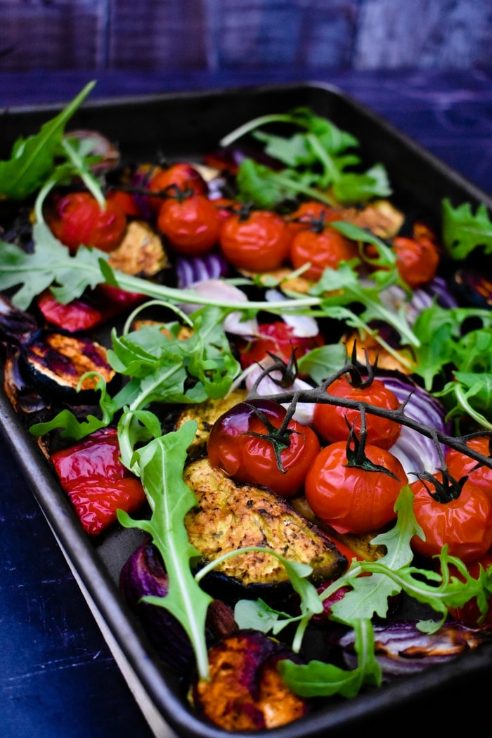 spiced roasted vegetables topped with rocket (arugula)