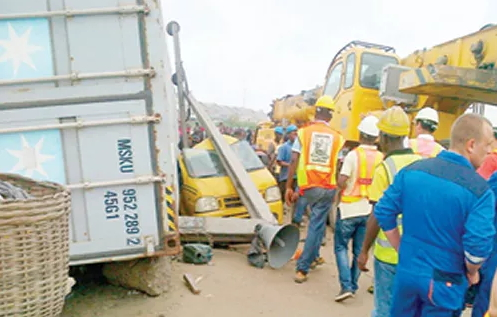 container crushes bus okadas lagos