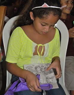 Honduran girl opening Christmas gift-Honduras, missions, Christmas outreach