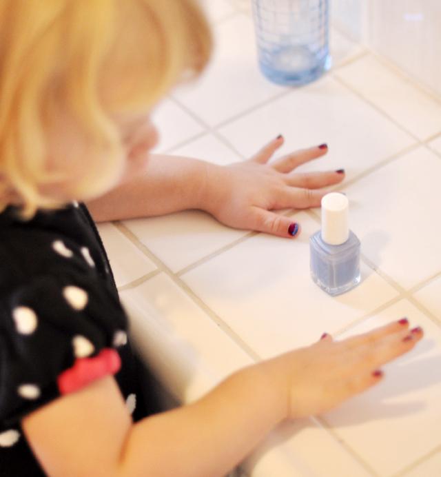 delilah admiring her nails