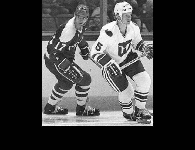 Vs. Hartford: Gordie and son Mark (5) played one NHL season together after the league absorbed 4 WHA teams. Is Tom Rowe (17) checking the surroundings? Two weeks after their Jan. 4, 1980 game, the Caps traded Rowe to Hartford