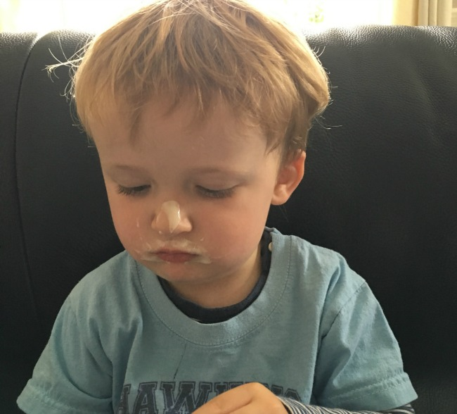 mishaps-and-mayhem-toddler-with-yoghurt-on-his-nose
