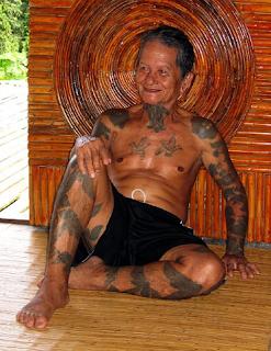 Tato Suku Dayak; tradisi, Religi, dan Status Sosial