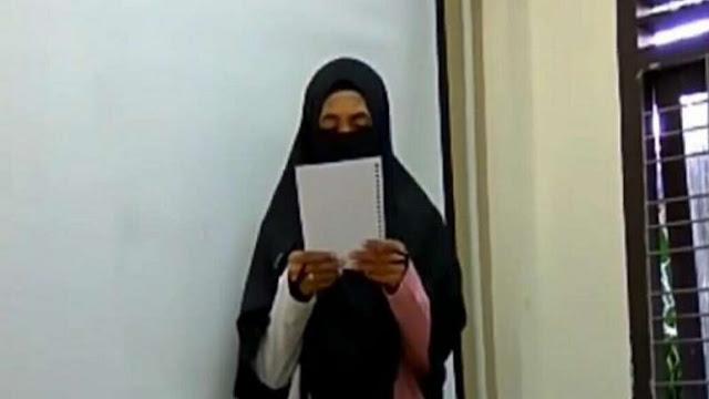 Wanita Bercadar Asal Aceh Balas Puisi Sukmawati